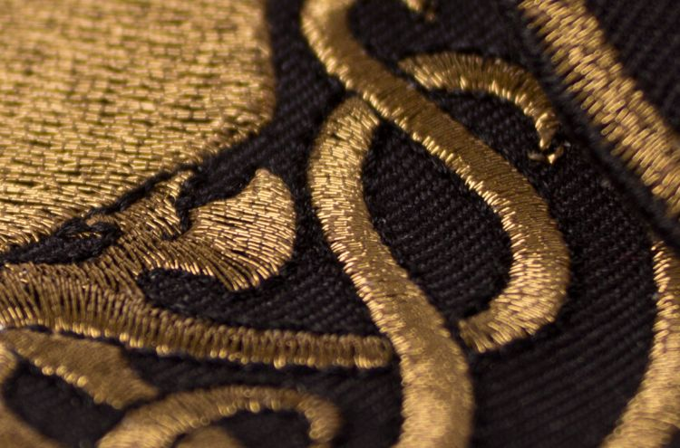 Patches embroidered with gold metalizing thread